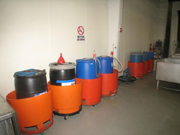 55 gallon drum in Orange safety covers